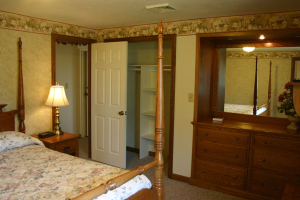 two-bedroom-suite-master-bed-room-closet-and-dresser